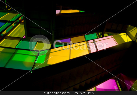 Colored light stock photo, Sunlight passing through colored windows and lighting staircase by Jean Larue-Frechette