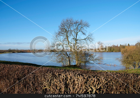 Spring Flood stock photo, Flooded fields after river bursts it's banks by Paul Phillips
