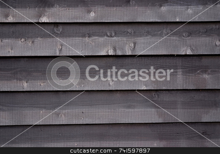 Wooden panels stock photo, Wooden bording panels on the outside of a house by Paul Phillips