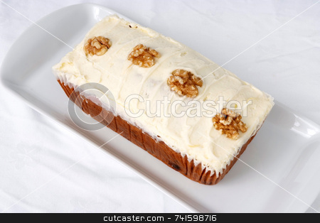 Ginger Cake stock photo, Mass-produced catering trade cake on a white background by Paul Phillips