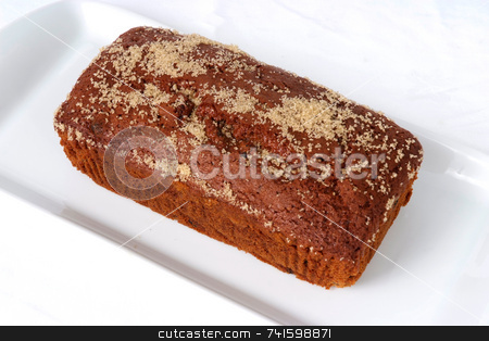 Ginger Cake stock photo, Mass-produced catering trade ginger cake on a white background by Paul Phillips