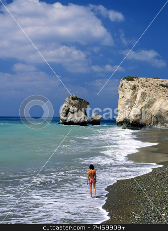 Aphrodite Rock stock photo, Aphrodite rock, Cyprus, with girl in foreground by Paul Phillips