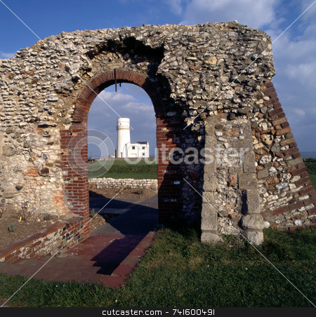 Ola and new stock photo, Lighthouse framed by the ruins of an old building by Paul Phillips