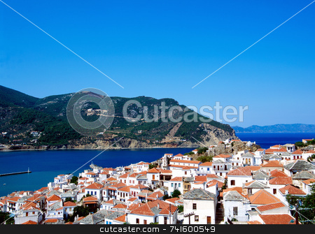 Skopelos harbour stock photo, Village at the entrance to Skopelos harbour by Paul Phillips