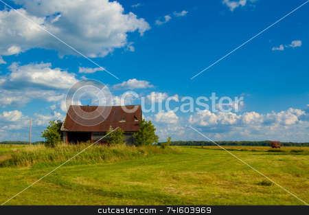 Old rusty barn stock photo, An old rusty barn in a field by Jean Larue-Frechette