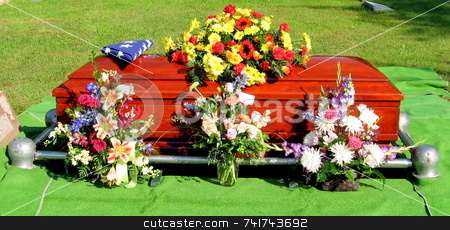 Flowers for a Veteran stock photo, At graveside services, flowers and a US flag honor a military veteran by Tom and Beth Pulsipher