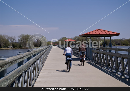 Bikers stock photo, Two bikers on river bridge by Ron Johnson
