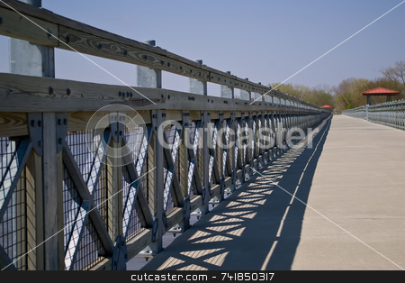 Railing stock photo, Hand rail along a pedestrian bridge with shadows by Ron Johnson