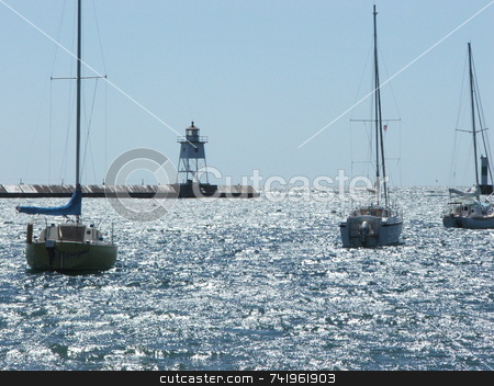 Grand Marais Harbor stock photo, Sunlight sparkles on the water of the Grand Marais, Minnesota harbor where three sailboats are at anchor.  Grand Marais is a popular tourist destination on Lake Superior's north shore. by Dennis Thomsen