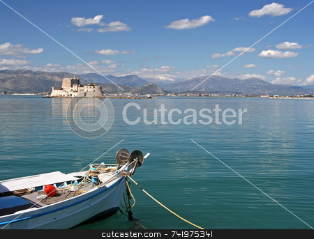 Boat and Castle Island stock photo, The castle island of Bourtzi, in Nafplio (Greece) with a boat in the foreground by Georgios Alexandris