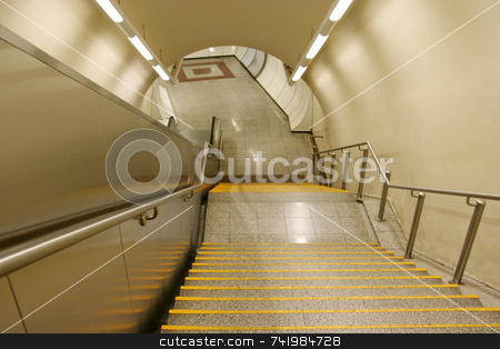 Subway Staircase stock photo, The staircase leading to the platform of a subway station by Georgios Alexandris