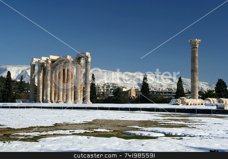 Zeus Olympius Temple in Winter stock photo, The ancient temple of Olympian Zeus in Athens, Greece, after a snowfall by Georgios Alexandris