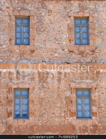 Windows in Stone Building stock photo, Four windows of an old stone building in the historic city of Nafplio, Greece by Georgios Alexandris