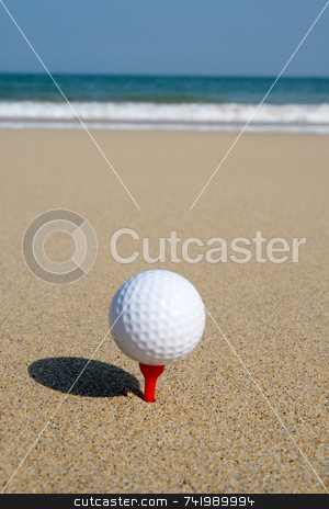 A golf ball on the beach, ready to be hit in to the ocean. stock photo, A golf ball on the beach, ready to be hit in to the ocean. by Stephen Rees