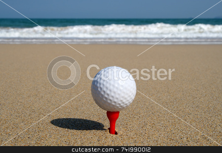 Golf ball on the beach, ready to be hit in to the ocean. stock photo, Golf ball on the beach, ready to be hit in to the ocean. by Stephen Rees