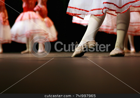 Recital dancers in white and red stock photo, Dancers on stage during a recital. Noise reduction was applied on the floor and the dancers in the background but not the foreground dancers. by Mitch Aunger