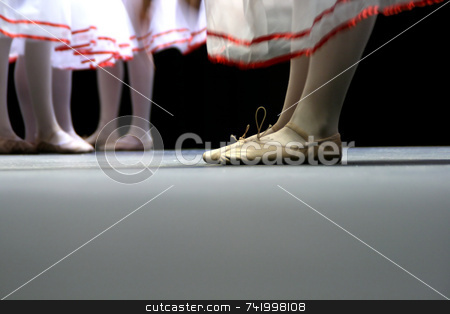 Ballet dancers with white skirts stock photo, Dancers on stage during a recital. Noise reduction was applied on the floor and the dancers in the background but not the foreground dancers. by Mitch Aunger