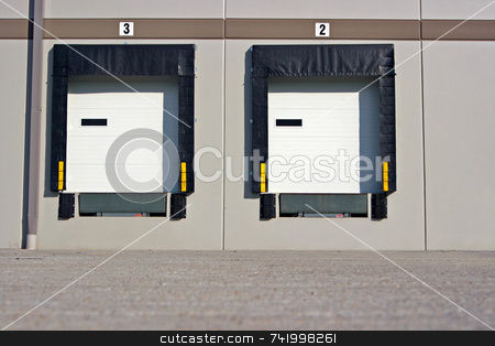 Loading Dock bays stock photo, Loading dock at a warehouse - showing just the doors and no trucks by Mitch Aunger