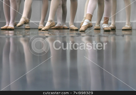 Dance stock photo, Young dancers... low angle shot of just feet and legs - this view has had the color removed from the floor and wall. by Mitch Aunger