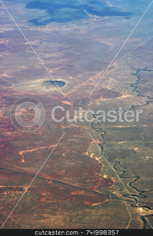 Meteor Crater in Arizona stock photo, Taken from an airplane, the meteor crater in Arizona is very easy to see. by Mitch Aunger