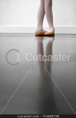 Dance Class stock photo, Young dancer in 5th position.. low angle shot of just feet and legs - this view has had the color removed from the floor and wall. by Mitch Aunger