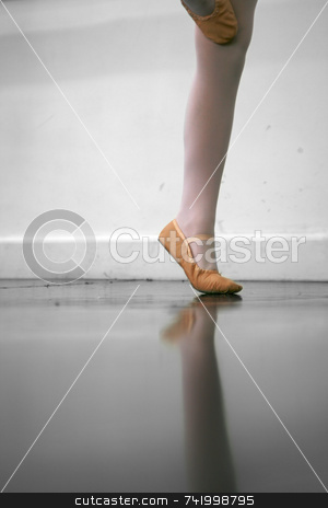 Dance Class stock photo, Young dancer... low angle shot of just feet and legs - this view has had the color removed from the floor and wall. by Mitch Aunger