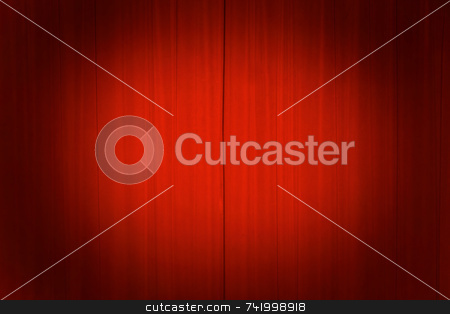 Theater curtains with a spotlight  stock photo, Bright red theater curtains with a spotlight on the center. by Mitch Aunger