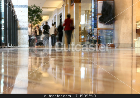 Mall Journey stock photo, People walking thru the mall - photograph taken from the floor giving a low-angle view and the people shopping are blurred and appear as ghosts by Mitch Aunger