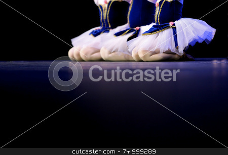 Dancers in blue and white stock photo, Performing on stage, a group of young dancers show off their talent and bright costumes - image highlights a narrow depth of field by Mitch Aunger