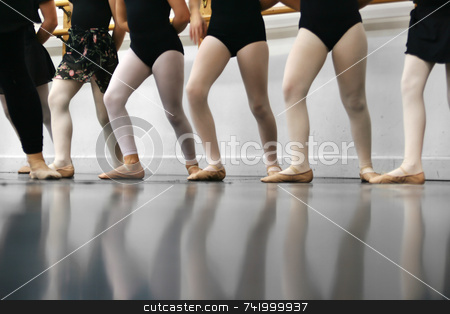 Dance Class stock photo, Young dancers are learning - they're all in a line trying to repeat what the instructor has shown them. by Mitch Aunger