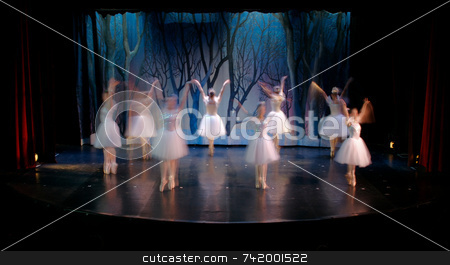 Nutcracker Dance stock photo, Dancers on stage performing - motion blurred (time lapse of 1 second) for effect. by Mitch Aunger