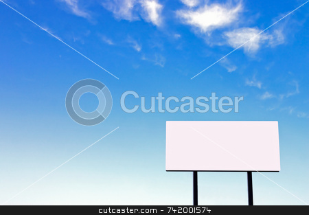 Billboard on a beautiful blue sky -small sign version stock photo, Brand new billboard and a wispy blue sky - the sun was on the left in the background sky giving a lighter left side of the image. by Mitch Aunger
