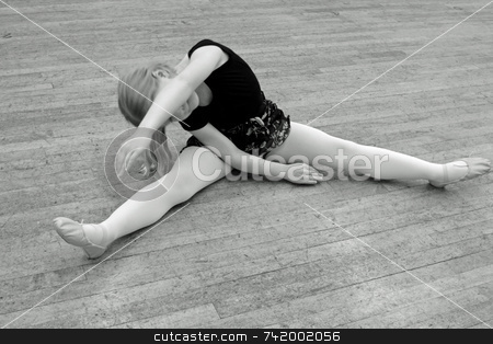 Dance stretch stock photo, Young dancer does her stretches while warming up by Mitch Aunger