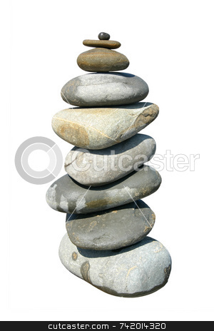 A large stack of beach stones. stock photo, A large stack of beach stones. by Stephen Rees