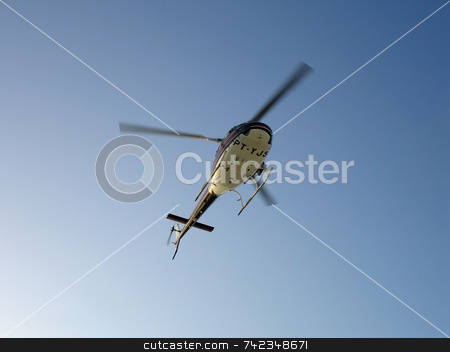 Helicopter stock photo, A helicopter in the air. by Daniel Wiedemann