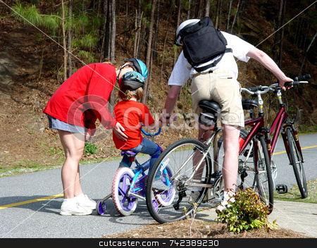 Comforting Parents stock photo, Mother and father comforting child after falling of bicycle by Jack Schiffer