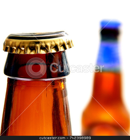 Bottles stock photo, Brown beer bottles with cap by Jack Schiffer