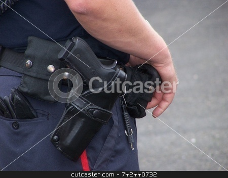 Policeman With Gun stock photo, Police office ever ready hand near gun by CHERYL LAFOND