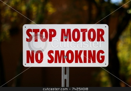Stop Motor No Smiking 6437 stock photo, Whit sign with text Stop Motor No Smiking by Henrik Lehnerer