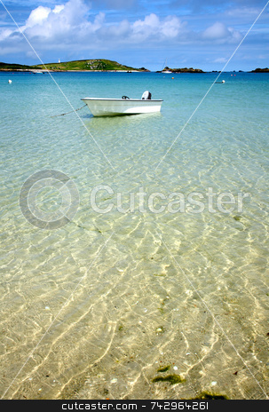 A white boat floating on clear sea, Isles of Scilly, Cornwall. stock photo, A white boat floating on clear sea, Isles of Scilly, Cornwall. by Stephen Rees