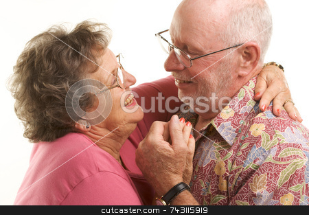 Happy Senior Couple Dancing stock photo, Happy Senior Couple romantically dancing. by Andy Dean