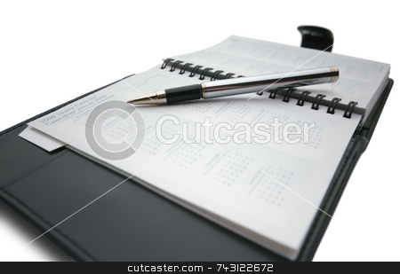 Pen on business day planner stock photo, Closeup of a business day planner with a pen by Vince Clements