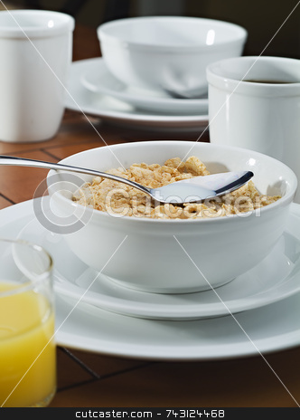 Morning breakfast cereal and coffee stock photo, Morning breakfast with cereal, coffee and juice by Vince Clements