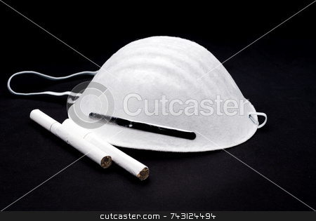Avoiding cigarettes stock photo, Breathing mask with cigarettes by Vince Clements
