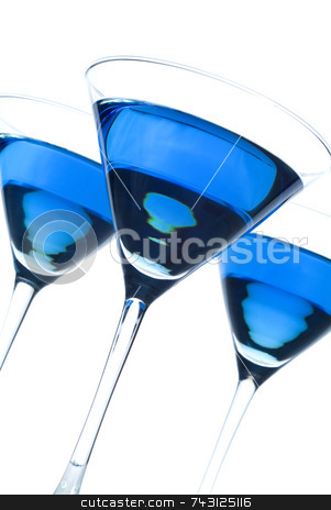 Three blueberry martinis titled stock photo, Three backlit blueberry martinis tilted view. by Vince Clements