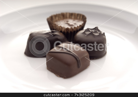 Close up of chocolates on a white plate stock photo, A closeup of some chocolates on a white plate. Suitable for Valentines Day topics, birthday topics, anniversary topics by Vince Clements