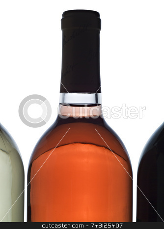 Backlit wine bottle stock photo, Backlit wine bottle between 2 other bottles by Vince Clements