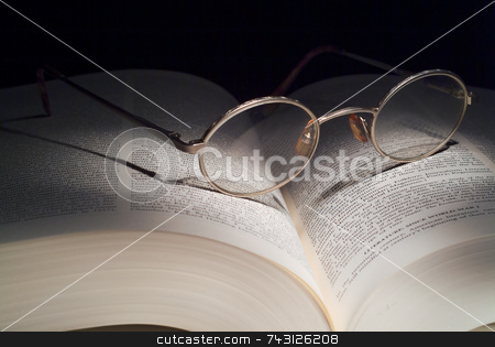 Reading Glasses on book stock photo, Reading glasses on large book. Lighting is painting with light. by Vince Clements
