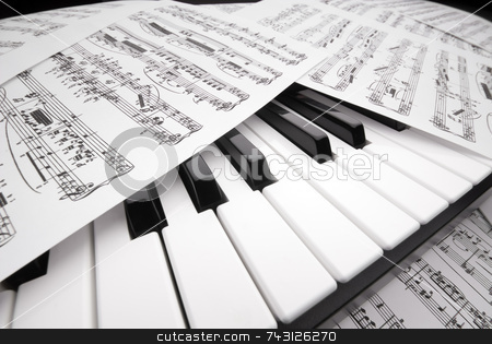 Piano and sheet music stock photo, Wide angle closeup of sheet music on a piano keyboard by Vince Clements