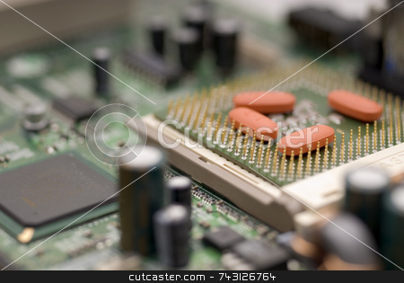 Computer virus stock photo, Pills on a computer processor - concept of a computer virus or a computer in need of repair by Vince Clements